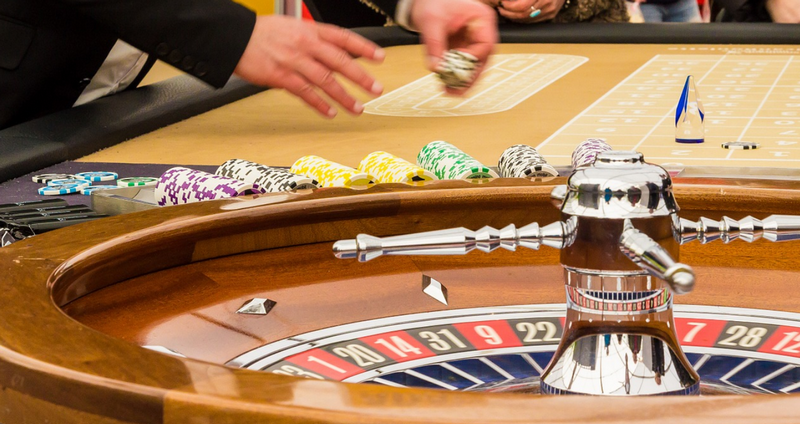 Roulette table and wheel with bettors